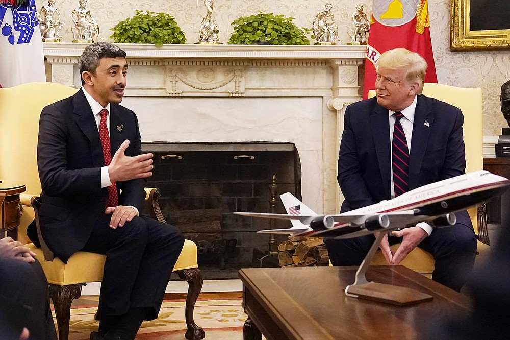President Donald Trump meets with United Arab Emirates Foreign Minister Abdullah bin Zayed al-Nahyan in the Oval Office, Tuesday, Sept. 15, 2020, at the White House in Washington. (AP Photo/Alex Brandon)