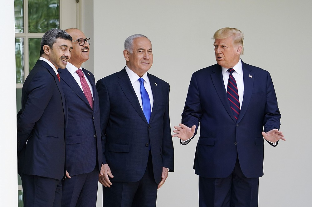 President Donald Trump walks to the Abraham Accords signing ceremony at the White House, Tuesday, Sept. 15, 2020, in Washington with Israeli Prime Minister Benjamin Netanyahu, Bahrain Foreign Minister Khalid bin Ahmed Al Khalifa and United Arab Emirates Foreign Minister Abdullah bin Zayed al-Nahyan. (AP Photo/Alex Brandon)