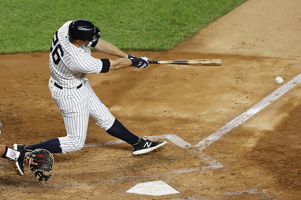 New York Yankees' DJ LeMahieu hits a three-run double during the third inning of the team's baseball game against the Toronto Blue Jays on Tuesday, Sept. 15, 2020, in New York. (AP Photo/Adam Hunger)