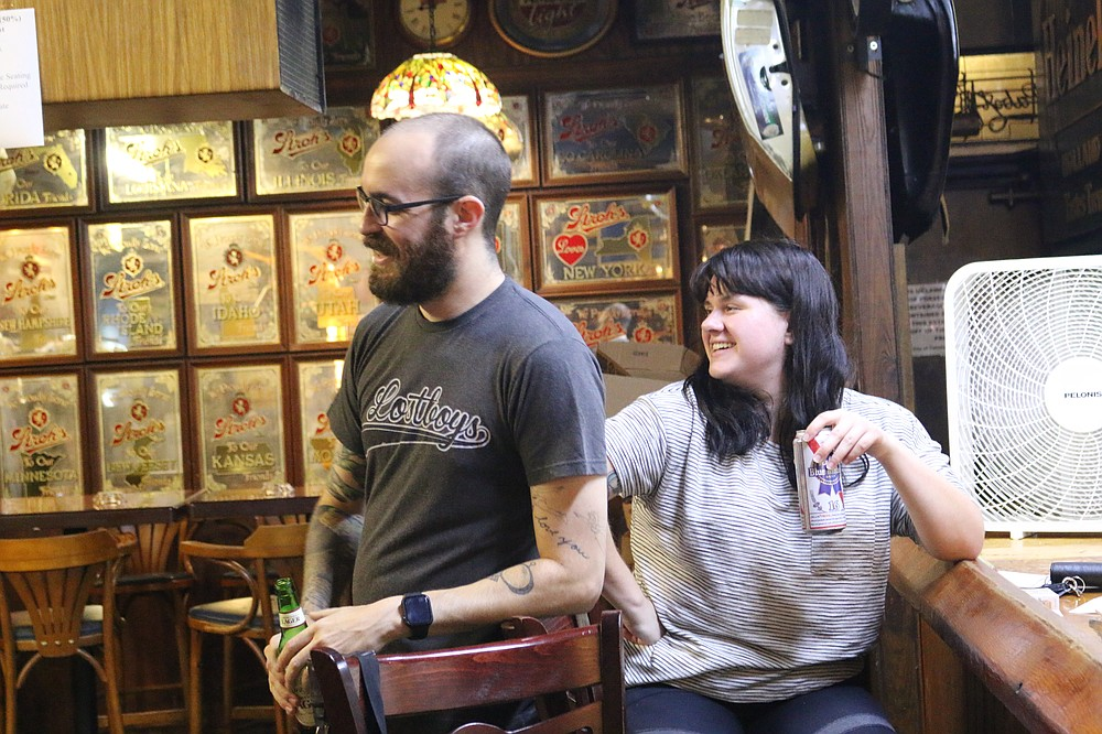 Zach Preston and his wife Allie Preston are regulars at The Leon Pub in Tallahassee, Fla. They spent Monday night, Sept. 14, 2020, at the once-popular watering hole. The pub hopes that more of its patrons will begin returning to help revive business in the wake of the coronavirus pandemic. (AP Photo/Bobby Caina Calvan)