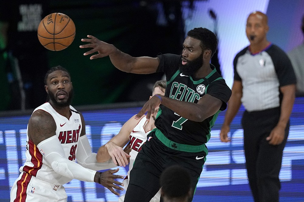 Boston Celtics' Jaylen Brown (7) makes a pass over Miami Heat's Jae Crowder, left, during the first half of an NBA conference final playoff basketball game, Tuesday, Sept. 15, 2020, in Lake Buena Vista, Fla. (AP Photo/Mark J. Terrill)