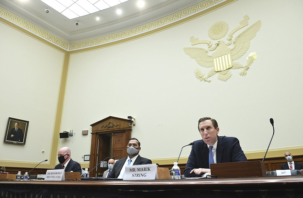 From left, R. Clarke Cooper, Assistant Secretary of State for Political-Military Affairs, Brian Bulatao, Under Secretary of State for Management, and Marik String, Acting Legal Adviser for the State Department, testify before a House Committee on Foreign Affairs hearing looking into the firing of State Department Inspector General Steven Linick, Wednesday, Sept. 16, 2020 on Capitol Hill in Washington. (Kevin Dietsch/Pool via AP)