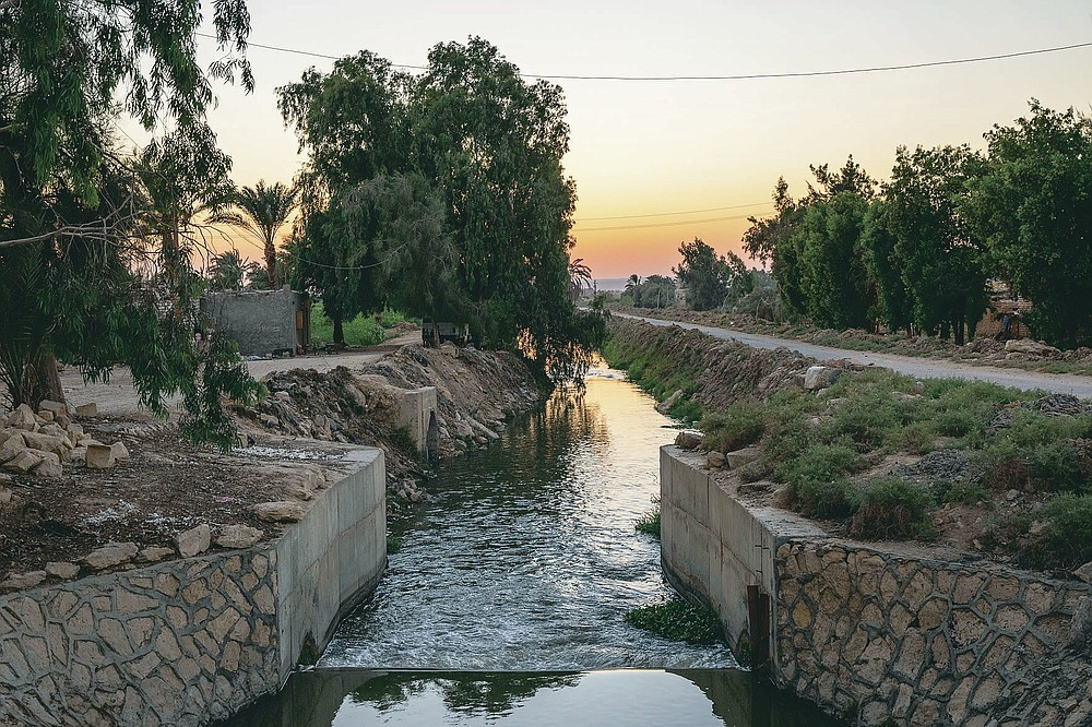 A source of water branching out of the Yusuf Canal, which flows from the Nile through Fayoum, in Qouta town, Egypt, Wednesday, Aug. 5, 2020. Egypt, which relies on the Nile for more than 90% of its water supplies, including drinking water, industrial use and irrigation, fears a devastating impact if The Grand Ethiopian Renaissance Dam is operated without taking its needs into account. (AP Photo/Nariman El-Mofty)