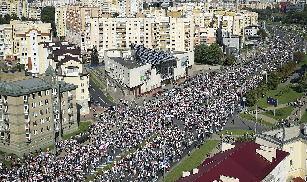 Protesters march during an opposition supporters rally in Minsk, Belarus, Sunday, Sept. 13, 2020. Protests calling for the Belarusian president's resignation have broken out daily since the Aug. 9 presidential election that officials say handed him a sixth term in office. (Tut.by via AP)
