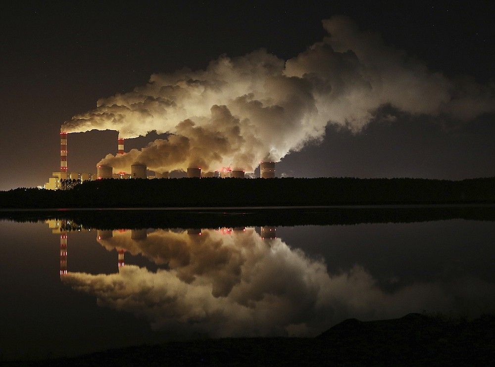 "FILE -- In this Wednesday, Nov. 28, 2018 file photo clouds of smoke are pictured over Europe's largest lignite power plant in Belchatow, central Poland. Government stimulus programs to pull the world out of the coronavirus pandemic offer ""a tremendous opportunity"" to build a clean-energy economy, former California governor Arnold Schwarzenegger said Thursday, calling on governments not to ""invest in the past."" Speaking video link from Los Angeles to the Austrian World Summit in Vienna, Schwarzenegger said that ""forward-looking decisions"" are needed now as trillions are being poured into rebuilding economies around the globe.A group of Greenpeace environment activists have climbed its 180-meter smokestack to spur participants in next week's global climate summit in Poland into taking decisions on limiting the use of coal.(AP Photo/Czarek Sokolowski, file)"