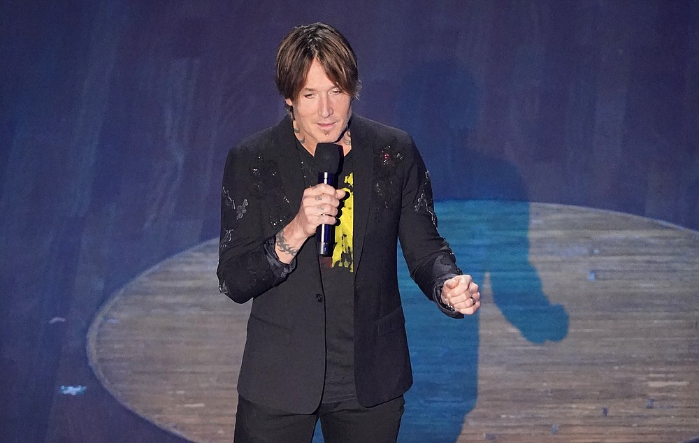 Keith Urban speaks during the 55th annual Academy of Country Music Awards at the Grand Ole Opry House on Wednesday, Sept. 16, 2020, in Nashville, Tenn. (AP Photo/Mark Humphrey)