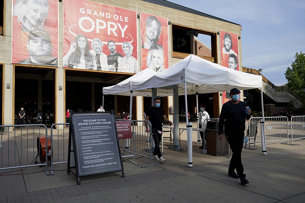 The entrance to the Grand Ole Opry House appears prior to the start of the 55th annual Academy of Country Music Awards on Wednesday, Sept. 16, 2020, in Nashville, Tenn. (AP Photo/Mark Humphrey)