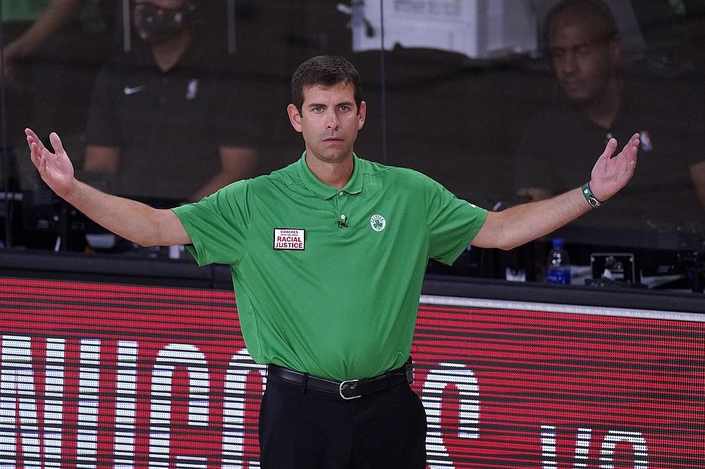 Boston Celtics head coach Brad Stevens gestures as he watches play against the Miami Heat during the second half of an NBA conference final playoff basketball game, Thursday, Sept. 17, 2020, in Lake Buena Vista, Fla. (AP Photo/Mark J. Terrill)