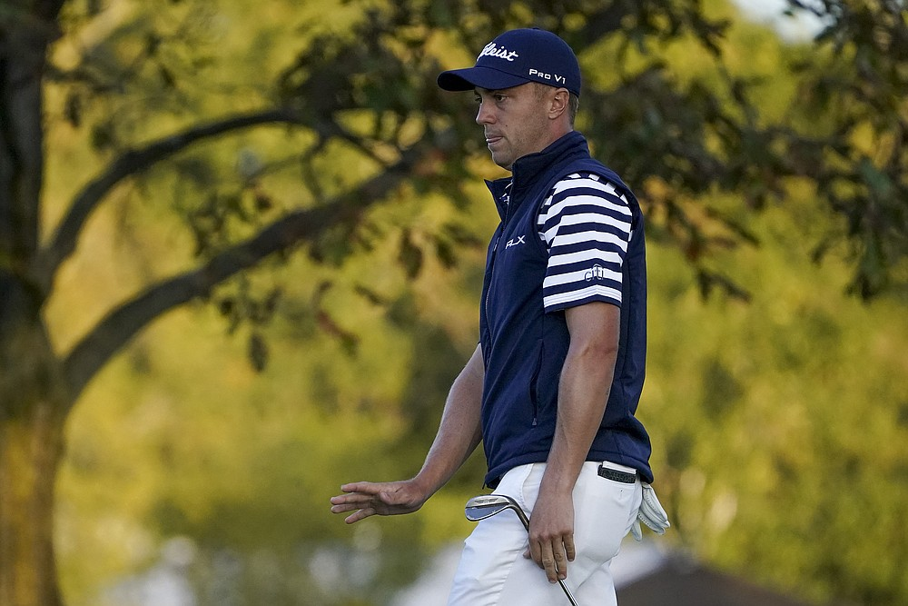 Justin Thomas, of the United States, reacts to his putt on the eighth green during the second round of the US Open Golf Championship, Friday, Sept. 18, 2020, in Mamaroneck, N.Y. (AP Photo/John Minchillo)