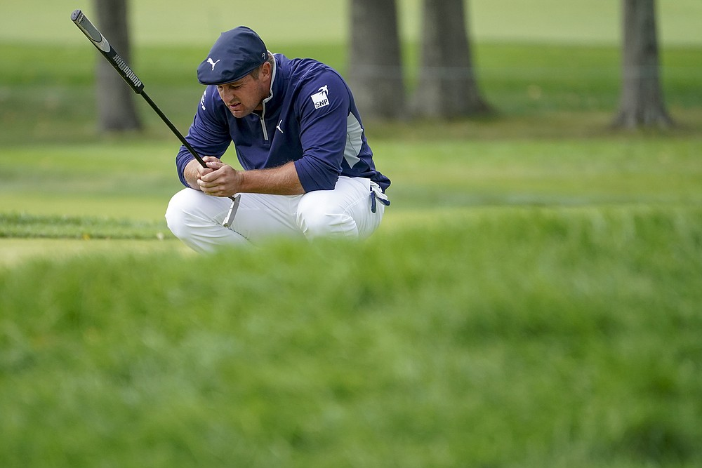 Bryson DeChambeau, of the United States, lines up a putt on the second green during the second round of the US Open Golf Championship, Friday, Sept. 18, 2020, in Mamaroneck, N.Y. (AP Photo/John Minchillo)