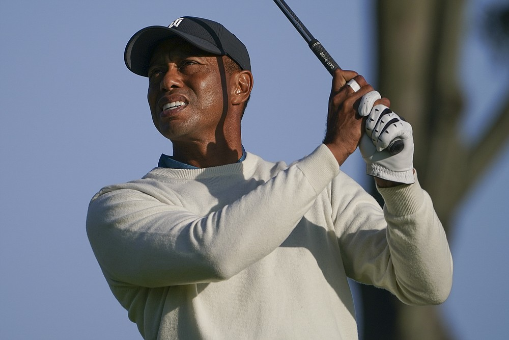 Tiger Woods, of the United States, plays his shot from the fourth tee during the second round of the US Open Golf Championship, Friday, Sept. 18, 2020, in Mamaroneck, N.Y. (AP Photo/John Minchillo)
