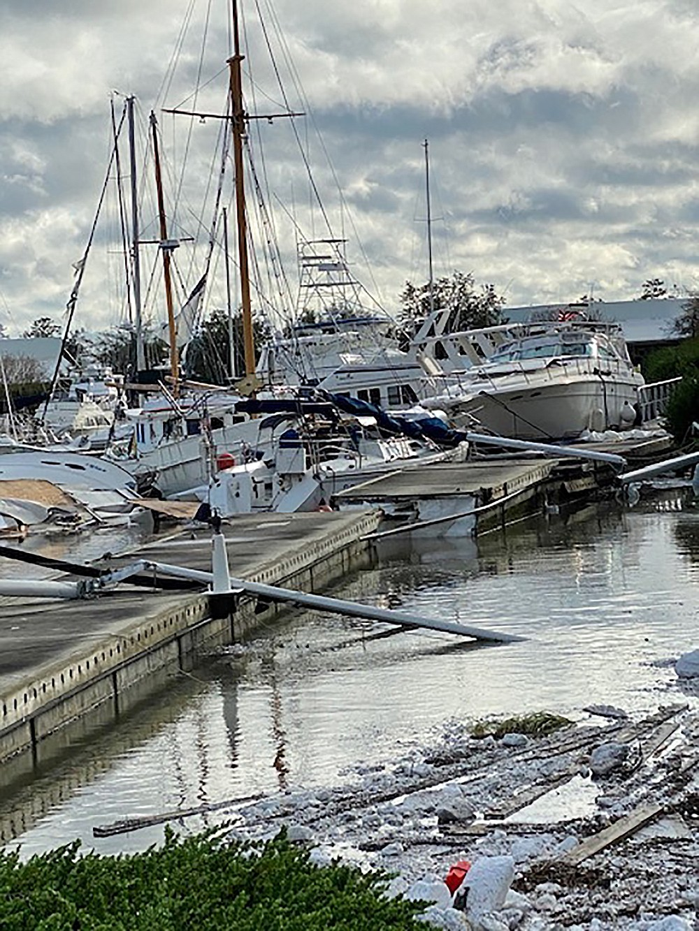 This photo provided by Tina Austin shows damage at the Barber Marina in Elberta, Ala., Wednesday, Sept. 16, 2020, caused by Hurricane Sally. (Tina Austin via AP)