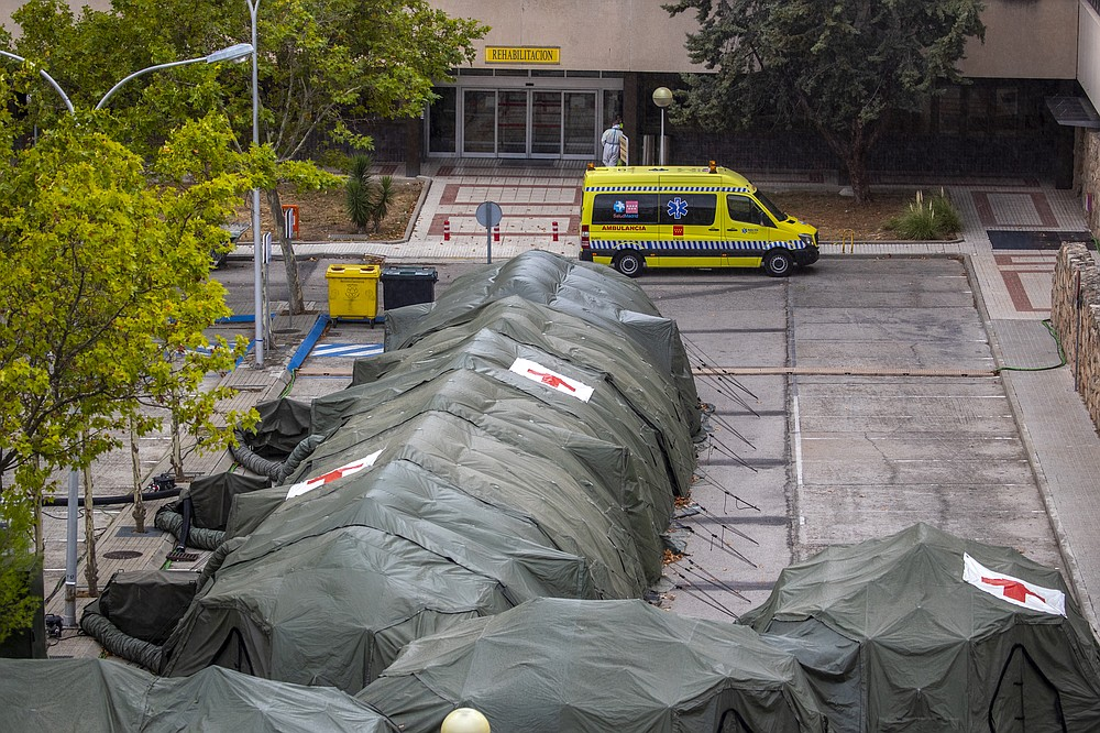 Spanish military tents are set out to be used by hospital patients during the coronavirus outbreak at the Gomez Ulla military hospital in Madrid, Spain, Friday, Sept. 18, 2020. A line of green tents have been installed at the gates of a Madrid military hospital four months after similar structures for triaging incoming patients and lighten up crammed emergency wards were taken down. (AP Photo/Manu Fernandez)