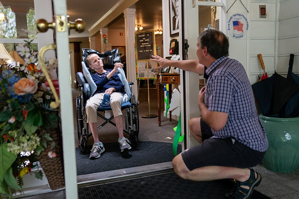 Dan Goerke, 61, visits his wife, Denise, at her assisted living facility in the Sandy Springs suburb of Atlanta on Aug. 5, 2020. Denise was diagnosed with Alzheimer's disease in 2012. MUST CREDIT: Photo for The Washington Post by Kevin D. Liles