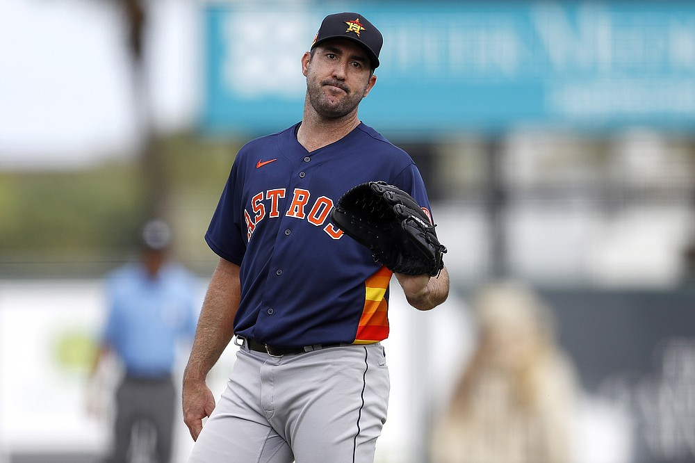 FILE - In this March 3, 2020, file photo, Houston Astros pitcher Justin Verlander reacts after a pitch during the third inning of a spring training baseball game against the St. Louis Cardinals in Jupiter, Fla.  The Astros announced Saturday, Sept. 19, 2020, that Verlander needs Tommy John surgery and could miss the entire 2021 season.  (AP Photo/Julio Cortez)