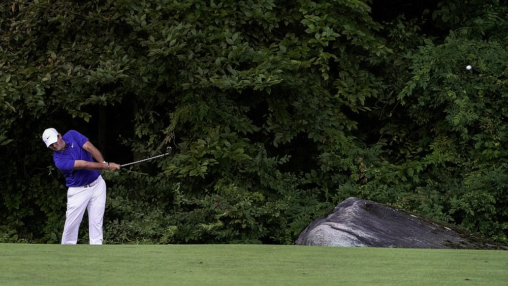 Patrick Reed, of the United States, plays a shot off the 15th fairway during the third round of the US Open Golf Championship, Saturday, Sept. 19, 2020, in Mamaroneck, N.Y. (AP Photo/John Minchillo)