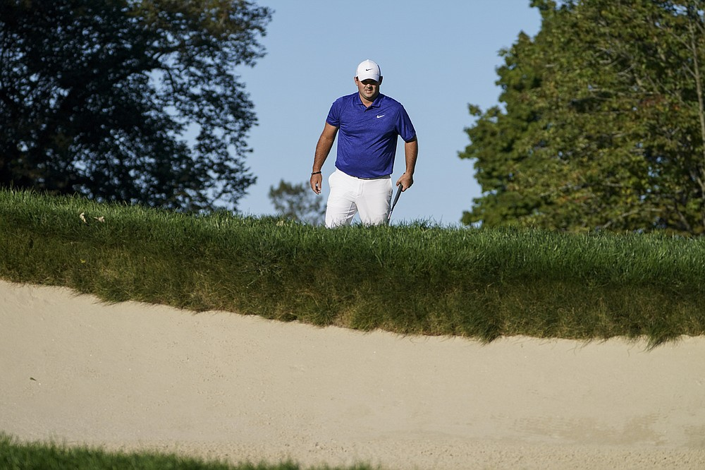 Patrick Reed, of the United States, walks on the 11th hole during the third round of the US Open Golf Championship, Saturday, Sept. 19, 2020, in Mamaroneck, N.Y. (AP Photo/John Minchillo)