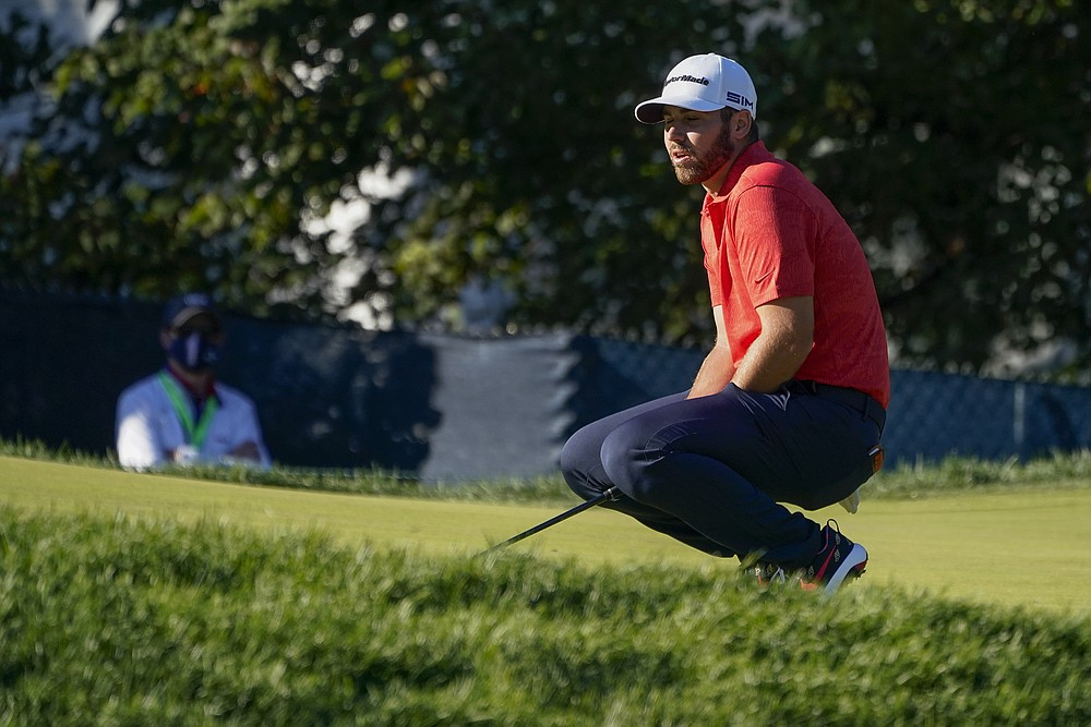 Matthew Wolff reacts after missing a putt for birdie on the 15th green during the third round of the US Open Golf Championship, Saturday, Sept. 19, 2020, in Mamaroneck, N.Y. (AP Photo/Charles Krupa)