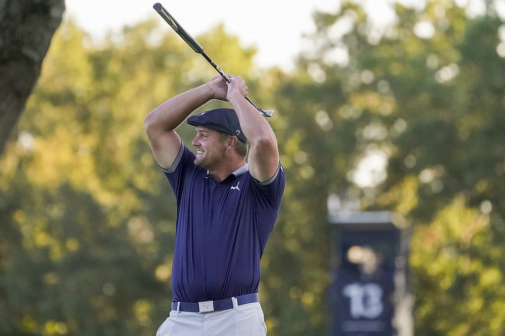 Bryson DeChambeau, of the United States, reacts after sinking a putt on the 16th green for birdie during the third round of the US Open Golf Championship, Saturday, Sept. 19, 2020, in Mamaroneck, N.Y. (AP Photo/John Minchillo)