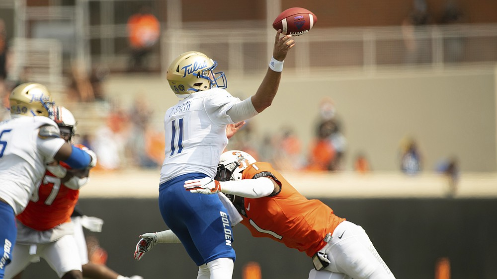 Oklahoma State linebacker Calvin Bundage (1) hits Tulsa quarterback Zach Smith (11) as he gets off a pass in the second half of an NCAA college football game Saturday, Sept. 19, 2020, in Stillwater, Okla. (AP Photo/Brody Schmidt)