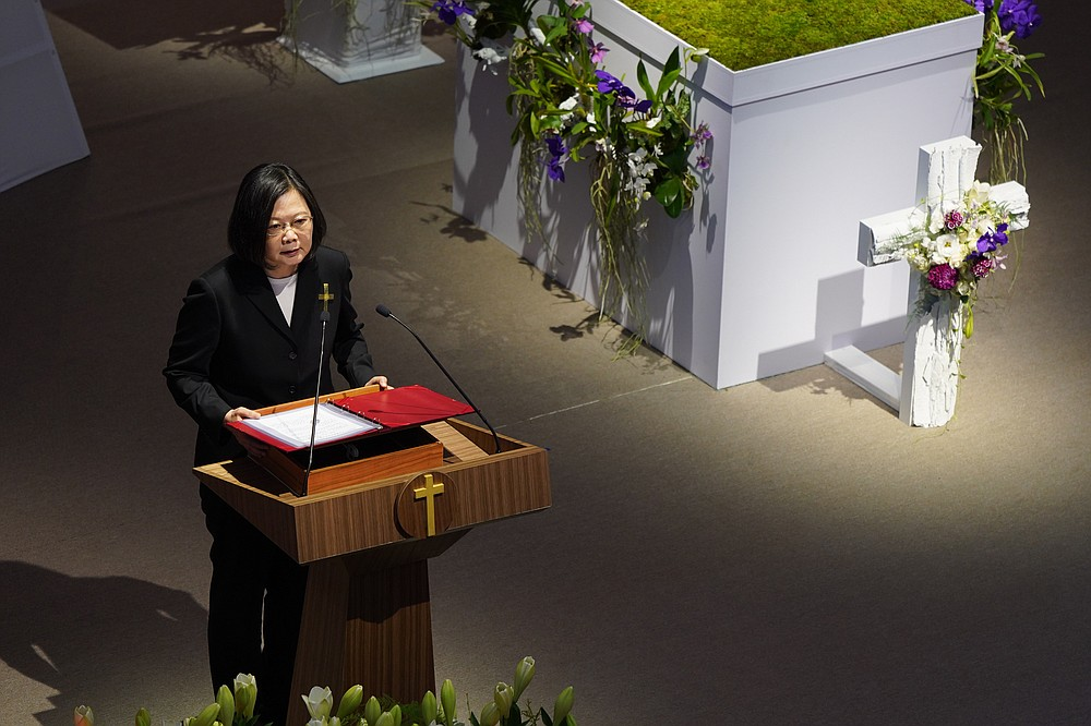 Taiwan President Tsai Ing-wen attends a memorial service for the late former Taiwanese President Lee Teng-hui in Taipei, Taiwan on Saturday, Sept. 19, 2020. Lee, remembered for leading the island's transition to democracy, died at age 97 in July, (Pool Photo via AP)