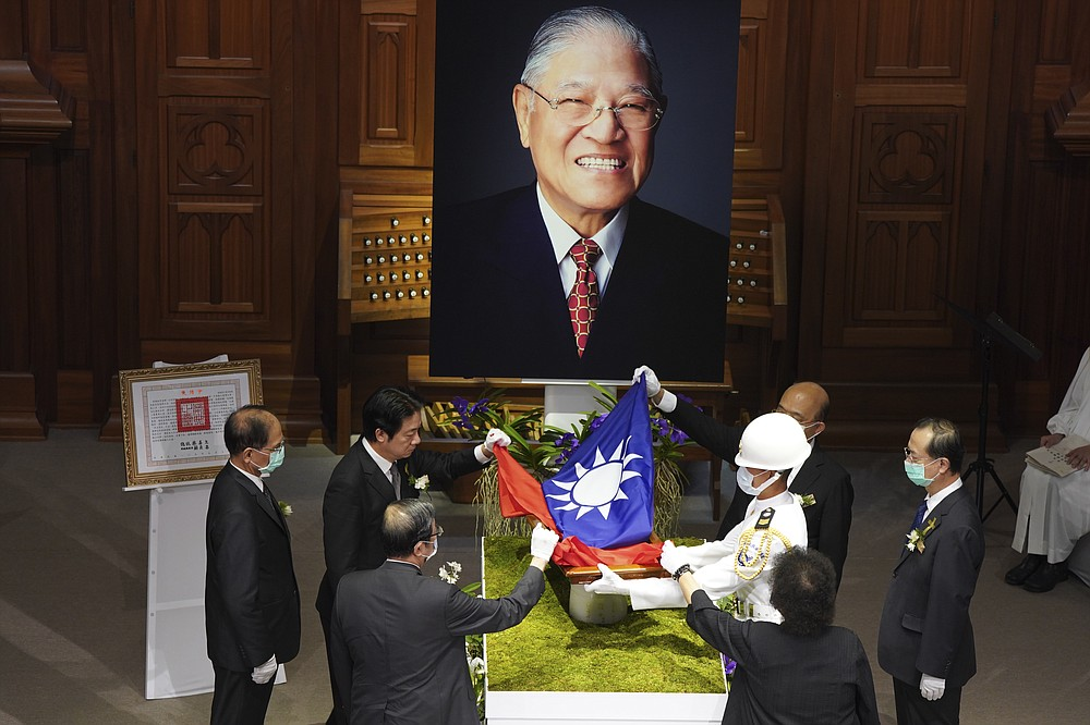 A Taiwanese flag is laid during a memorial service for the late former Taiwanese President Lee Teng-hui in Taipei, Taiwan on Saturday, Sept. 19, 2020. Lee, remembered for leading the island's transition to democracy, died at age 97 in July, (Pool Photo via AP Photo)