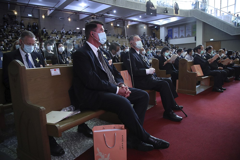 U.S. Undersecretary of State Keith Krach, center and former Japanese Prime Minister Yoshiro Mori at right attend a memorial service for the late former Taiwanese President Lee Teng-hui in Taipei, Taiwan on Saturday, Sept. 19, 2020. Lee, remembered for leading the island's transition to democracy, died at age 97 in July, (Pool Photo via AP Photo)