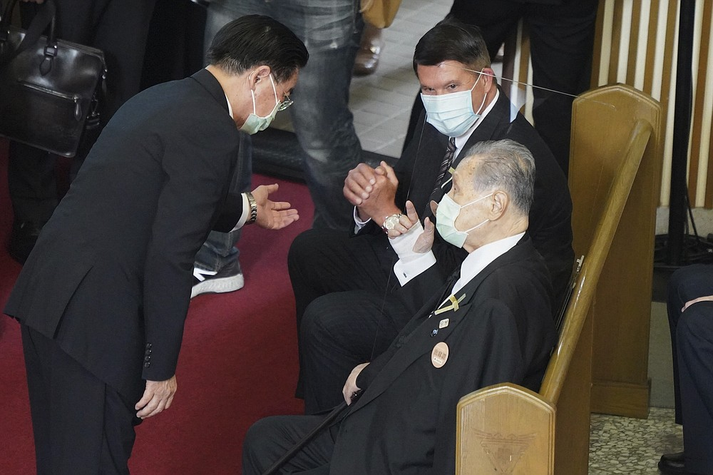 Former Japanese Prime Minister Yoshiro Mori, center is seated next to U.S. Under Secretary of State Keith Krach, at a memorial service for the late former Taiwanese President Lee Teng-hui in Taipei, Taiwan on Saturday, Sept. 19, 2020. Lee, remembered for leading the island's transition to democracy, died at age 97 in July, (Pool Photo via AP)