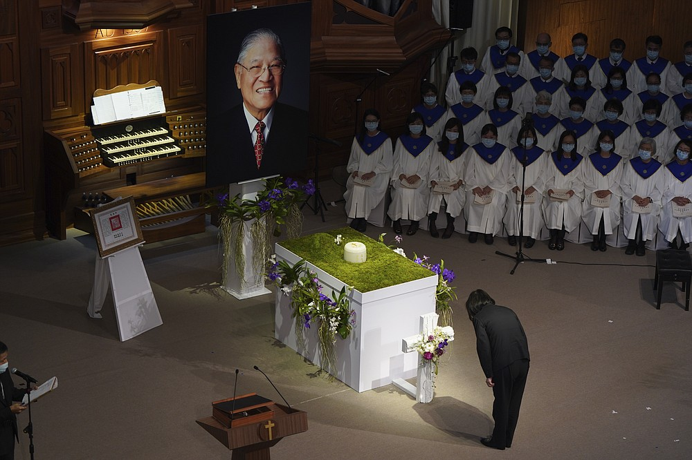 Taiwan President Tsai Ing-wen bows during a memorial service for the late former Taiwanese President Lee Teng-hui in Taipei, Taiwan on Saturday, Sept. 19, 2020. Lee, remembered for leading the island's transition to democracy, died at age 97 in July, (Pool Photo via AP)