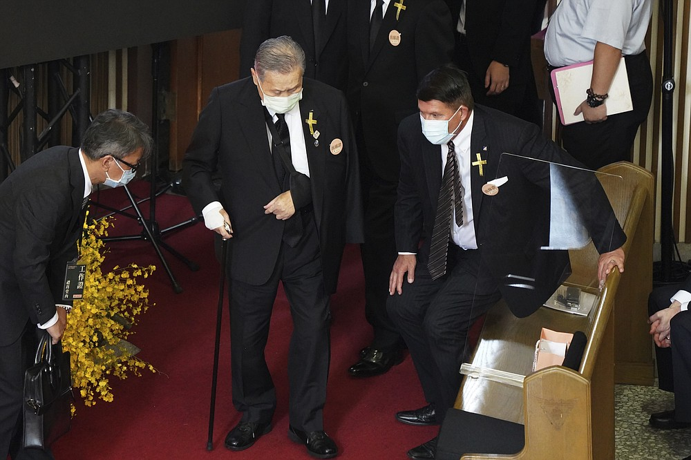 U.S. Undersecretary of State Keith Krach, at right rise as former Japanese Prime Minister Yoshiro Mori center arrives at a memorial service for the late former Taiwanese President Lee Teng-hui in Taipei, Taiwan on Saturday, Sept. 19, 2020. Lee, remembered for leading the island's transition to democracy, died at age 97 in July, (Pool Photo via AP Photo)