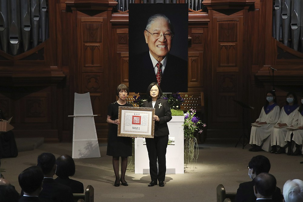 Taiwan President Tsai Ing-wen, center right, presents a posthumous citation for the late Taiwanese President Lee Teng-Hui to his daughter Anna Lee during a memorial service for the former president who led the island's transition to democracy and died at age 97 in July, in Taipei, Taiwan on Saturday, Sept. 19, 2020. (Pool Photo via AP Photo)