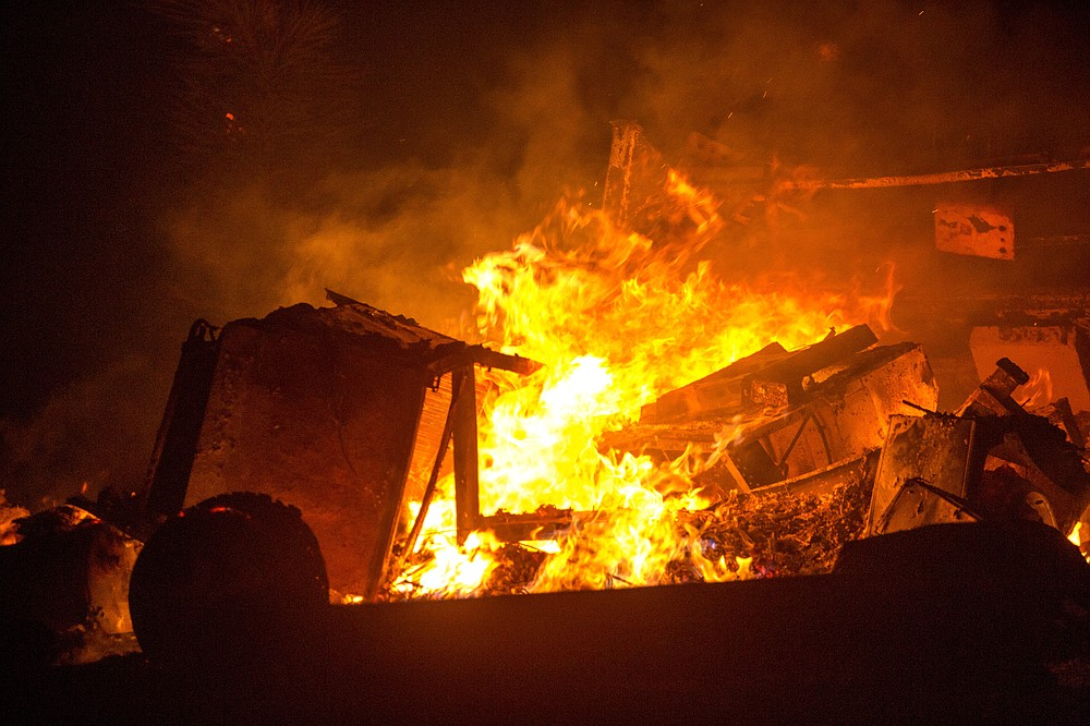 A recreational vehicle is consumed by the Bobcat Fire in Juniper Hills, Calif., Friday, Sept. 18, 2020. (AP Photo/Ringo H.W. Chiu)