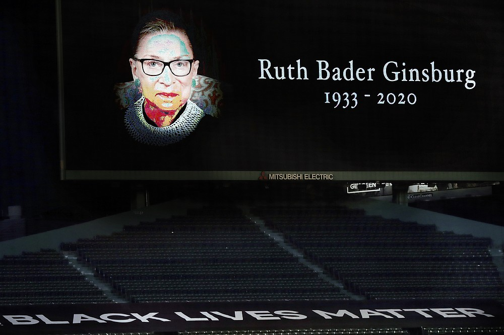 A memorial to late Supreme Court Justice Ruth Bader Ginsburg is displayed at Fenway Park before a baseball game between the Boston Red Sox and the New York Yankees, Saturday, Sept. 19, 2020, in Boston. (AP Photo/Michael Dwyer)