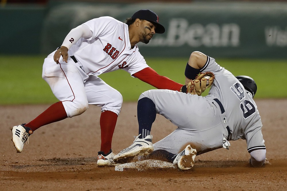 Boston Red Sox's Xander Bogaerts catches New York Yankees' Aaron Judge (99) attempting to steal second base during the fifth inning of a baseball game, Saturday, Sept. 19, 2020, in Boston. (AP Photo/Michael Dwyer)