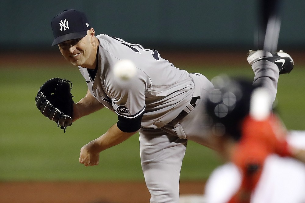 New York Yankees' J.A. Happ pitches during the first inning of a baseball game against the Boston Red Sox, Saturday, Sept. 19, 2020, in Boston. (AP Photo/Michael Dwyer)