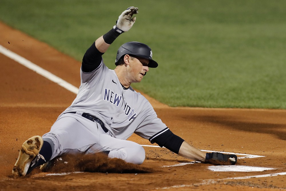 New York Yankees' DJ LeMahieu scores on a sacrifice fly by Gio Urshela during the first inning of a baseball game against the Boston Red Sox, Saturday, Sept. 19, 2020, in Boston. (AP Photo/Michael Dwyer)