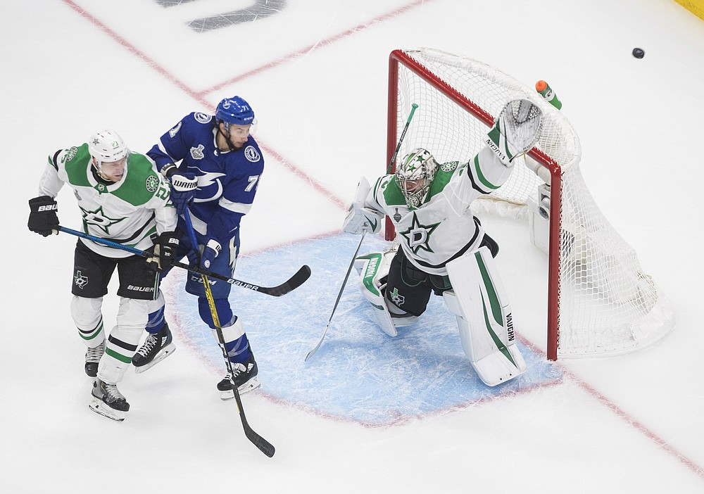 Dallas Stars goaltender Anton Khudobin (35) makes a save as Tampa Bay Lightning's Anthony Cirelli (71) and Stars' Esa Lindell (23) battle in front during second-period NHL Stanley Cup finals hockey action in Edmonton, Alberta, Saturday, Sept. 19, 2020. (Jason Franson/The Canadian Press via AP)