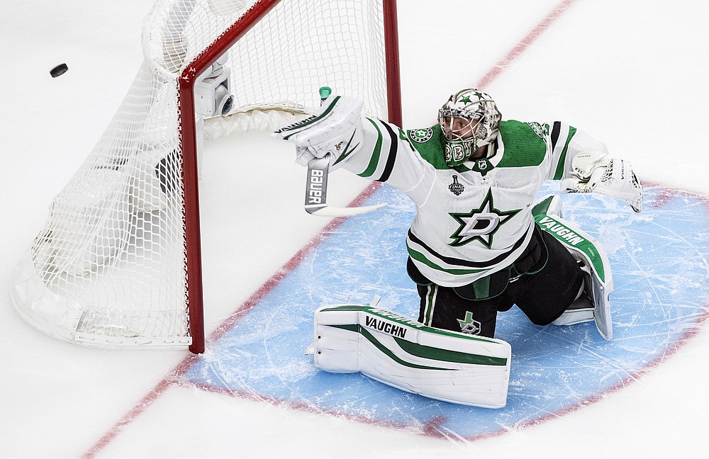 Dallas Stars goaltender Anton Khudobin (35) makes a save against the Tampa Bay Lightning during first-period NHL Stanley Cup finals hockey action in Edmonton, Alberta, Saturday, Sept. 19, 2020. (Jason Franson/The Canadian Press via AP)