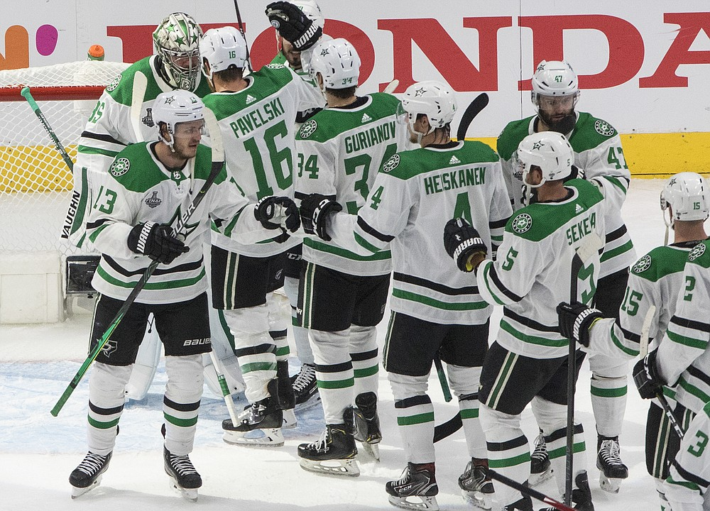 The Dallas Stars celebrate their win over the Tampa Bay Lightning in NHL Stanley Cup finals hockey action in Edmonton, Alberta, Saturday, Sept. 19, 2020. (Jason Franson/The Canadian Press via AP)