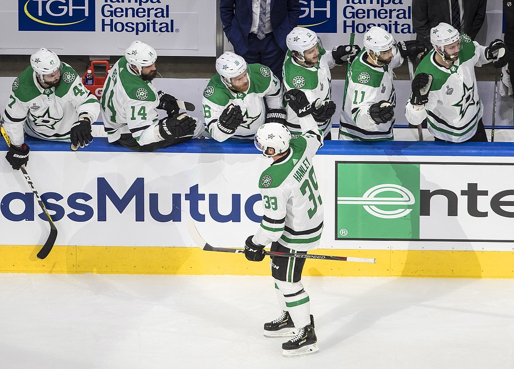 Dallas Stars defenseman Joel Hanley (39) celebrates his goal against the Tampa Bay Lightning with teammates on the bench during first-period NHL Stanley Cup finals hockey action in Edmonton, Alberta, Saturday, Sept. 19, 2020. (Jason Franson/The Canadian Press via AP)