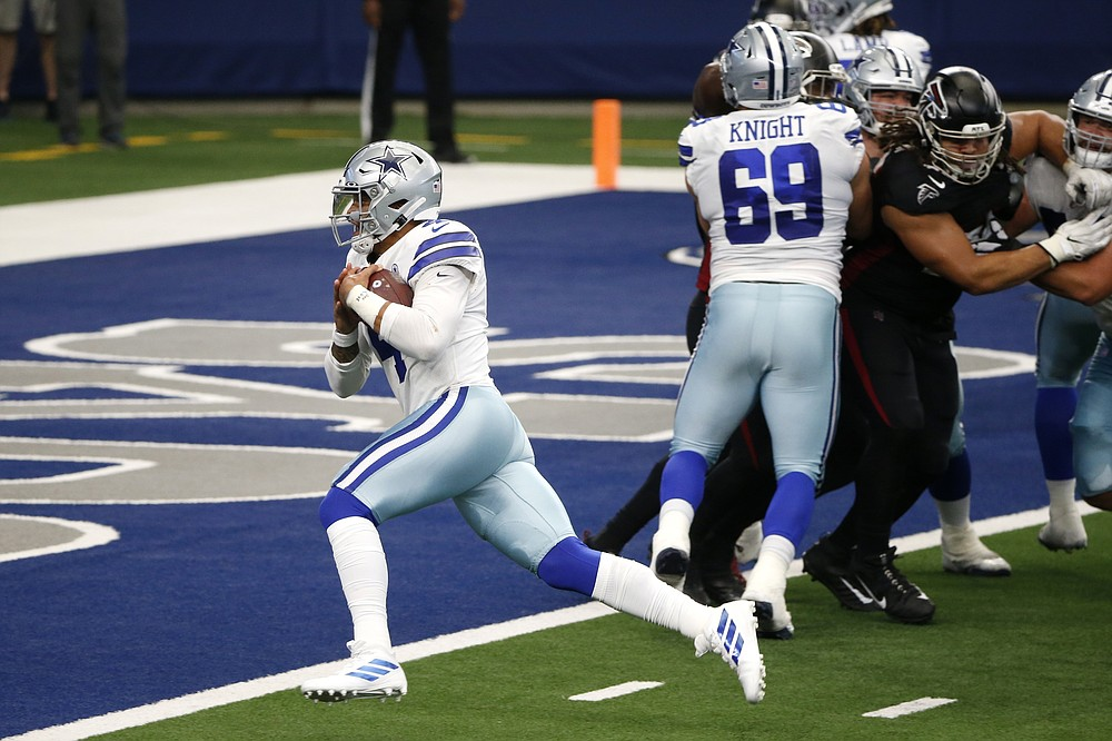 Dallas Cowboys quarterback Dak Prescott (4) reaches the end zone for a touchdown as Brandon Knight (69) provides coverage against the Atlanta Falcons in the second half of an NFL football game in Arlington, Texas, Sunday, Sept. 20, 2020. (AP Photo/Michael Ainsworth)