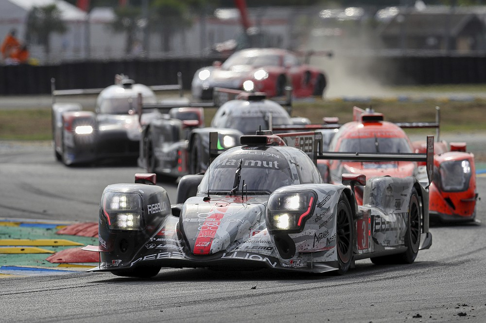 The Rebellion R13 No3 of the Rebellion Racing Team driven by Nathanael Berthon of France, Romain Dumas of France and Louis Deletraz of Switzerland in action during the 88th 24-hour Le Mans endurance race, in Le Mans, western France, Sunday, Sept. 20, 2020. Due to coronavirus crisis, the race takes place without spectators. (AP Photo/David Vincent)
