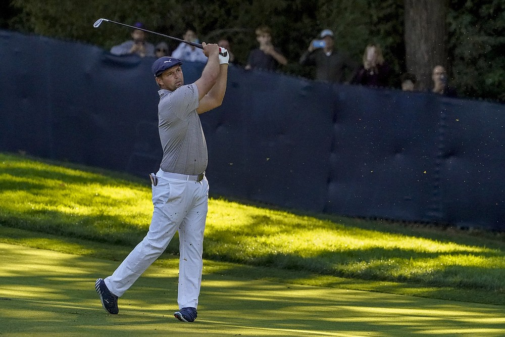 Bryson DeChambeau, of the United States, plays a shot on the 15th hole during the final round of the US Open Golf Championship, Sunday, Sept. 20, 2020, in Mamaroneck, N.Y. (AP Photo/John Minchillo)