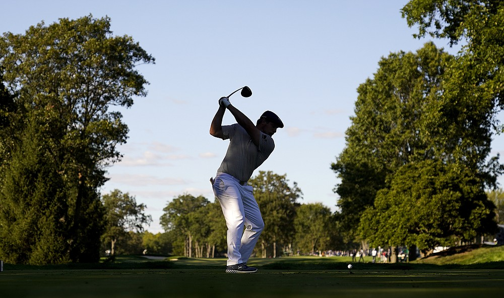 Bryson DeChambeau, of the United States, plays his shot from the 14th tee during the final round of the US Open Golf Championship, Sunday, Sept. 20, 2020, in Mamaroneck, N.Y. (AP Photo/Charles Krupa)