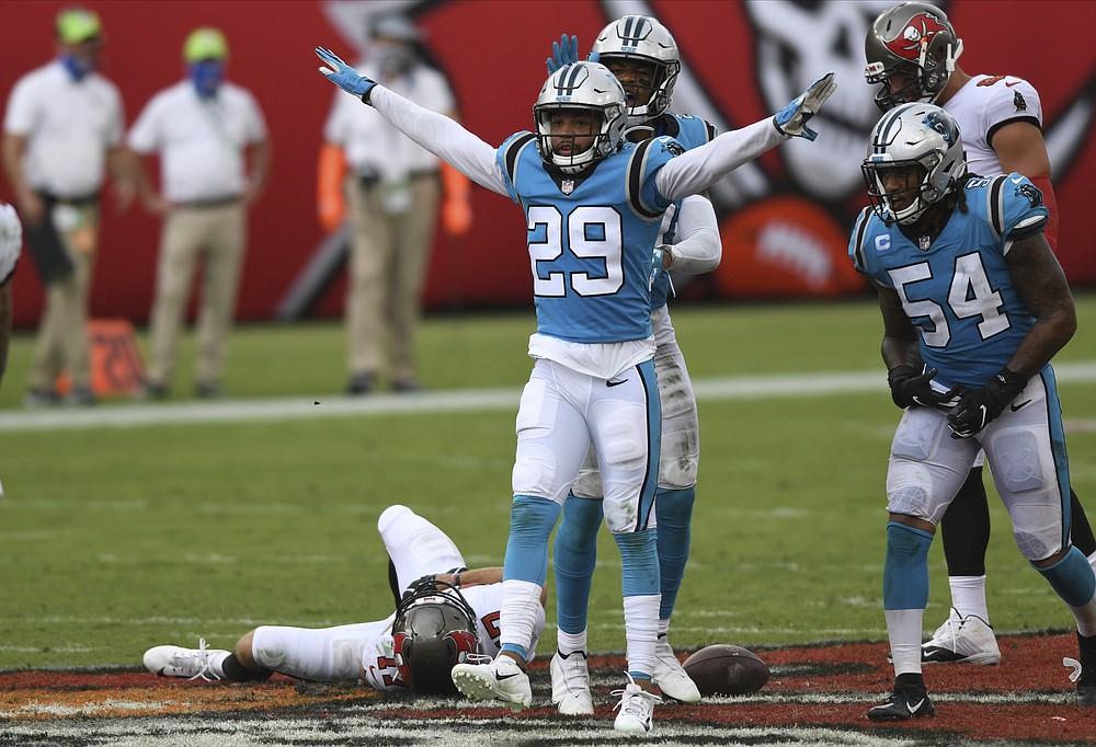 Carolina Panthers cornerback Corn Elder (29) celebrates after stopping Tampa Bay Buccaneers wide receiver Justin Watson (17) during the second half of an NFL football game Sunday, Sept. 20, 2020, in Tampa, Fla. (AP Photo/Jason Behnken)