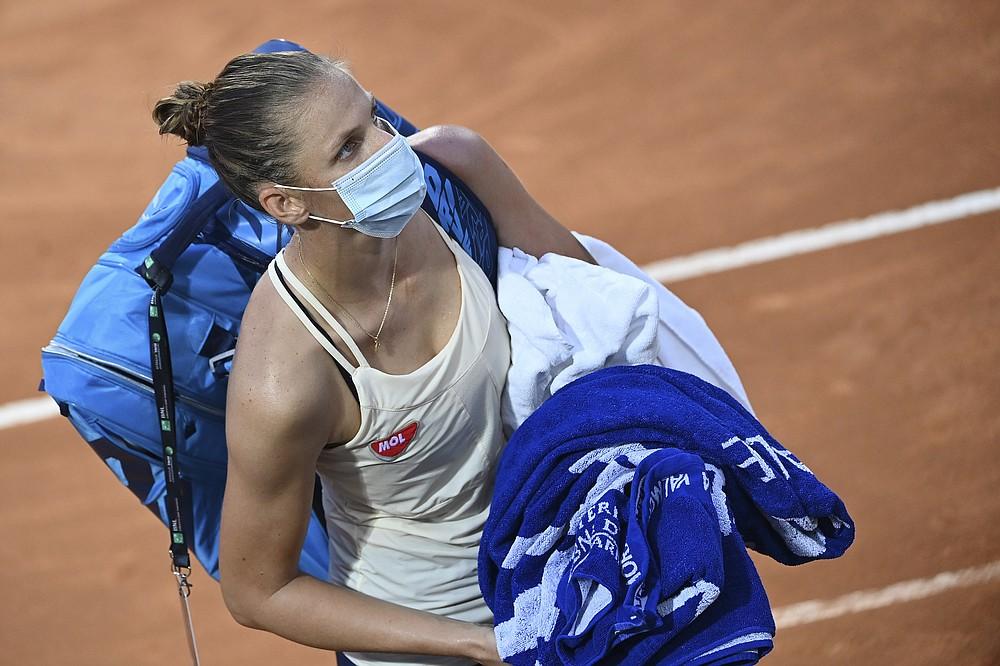 Czech Republic's Karolina Pliskova leaves after winning her match with Marketa Vondrousova during their semifinal at the Italian Open tennis tournament, in Rome, Sunday, Sept. 20, 2020. (Alfredo Falcone/LaPresse via AP)