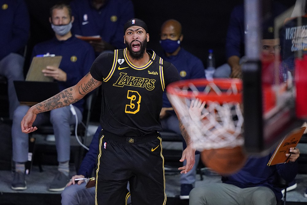 Los Angeles Lakers' Anthony Davis (3) reacts after making a 3-point basket during the second half of an NBA conference final playoff basketball game against the Denver Nuggets Sunday, Sept. 20, 2020, in Lake Buena Vista, Fla. (AP Photo/Mark J. Terrill)