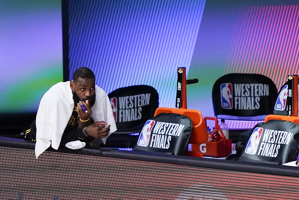 Los Angeles Lakers' LeBron James sits on the bench during the second half of an NBA conference final playoff basketball game against the Denver Nuggets Sunday, Sept. 20, 2020, in Lake Buena Vista, Fla. (AP Photo/Mark J. Terrill)