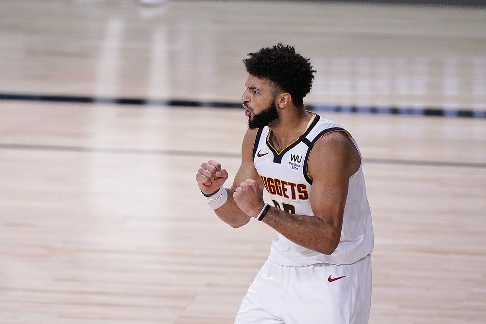 Denver Nuggets' Jamal Murray (27) celebrates during the second half of an NBA conference final playoff basketball game against the Los Angeles Lakers Sunday, Sept. 20, 2020, in Lake Buena Vista, Fla. (AP Photo/Mark J. Terrill)