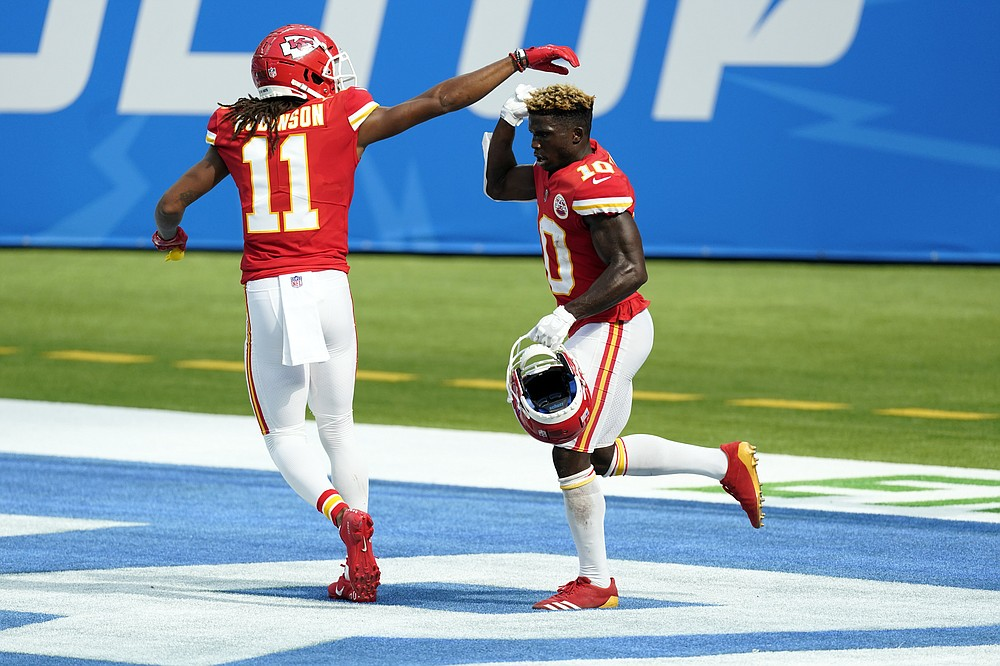 Kansas City Chiefs wide receiver Tyreek Hill, right, celebrates his touchdown catch with wide receiver Demarcus Robinson (11) during the second half of an NFL football game against the Los Angeles Chargers Sunday, Sept. 20, 2020, in Inglewood, Calif. (AP Photo/Ashley Landis)